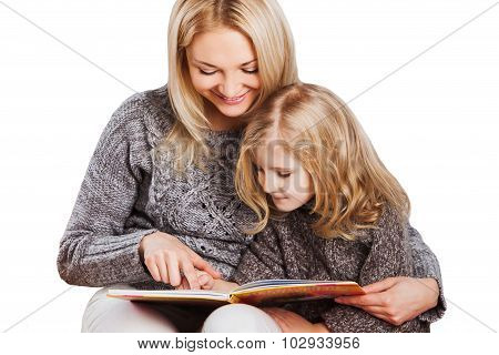 Mother reading with little daughter
