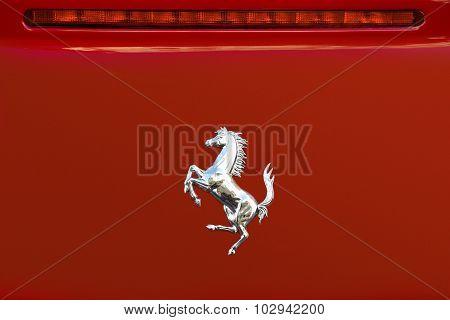 Ferrari Logo On The Back Of A Red Ferrari