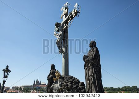 View Of Prague Castle From Charles Bridge With Holy Crucifix And Calvary