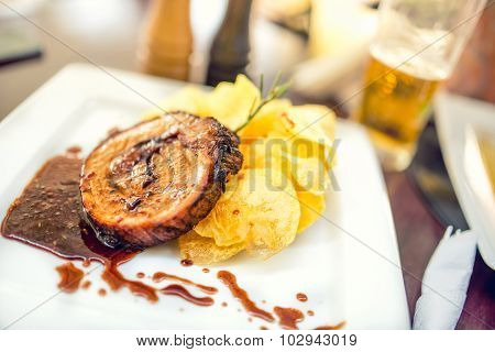 Porc Chop On Grill With Chips As Main Course At Local Restaurant, Fancy Dish, Internationa Cuisine
