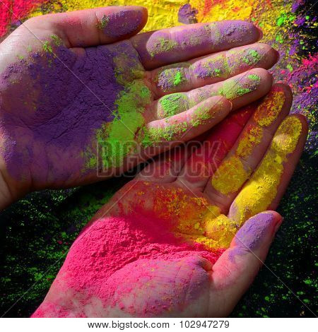 Hands with holi paint