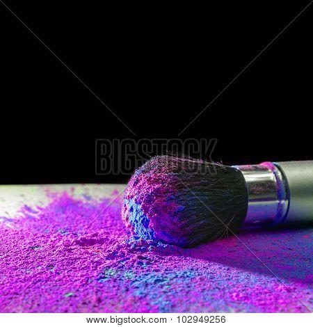Makeup brush with holi paint