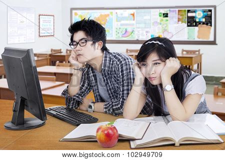 Two Bored Student Studying In The Class