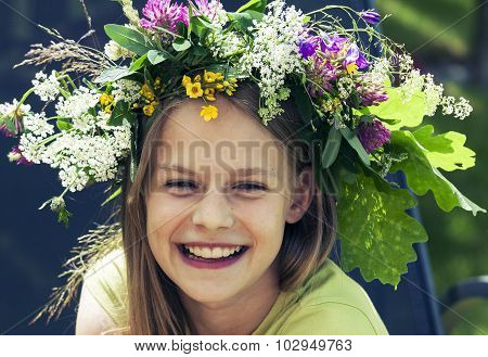 Happy Smiling Girl With Flower Wreath