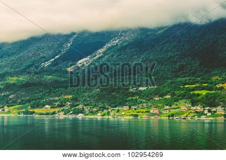 Scandinavian village on shore of Hardangerfjord. The Hardangerfjord is the fourth longest fjord in the world, and the second longest fjord in Norway. poster
