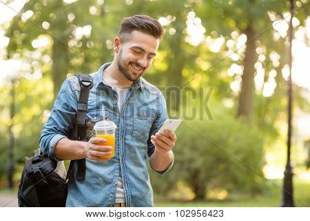 Hipster man walking in autumn park