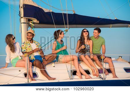 Cheerful young people relaxing on a yacht.