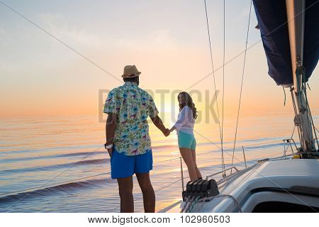 Date of guy and girl on a yacht.
