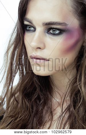 young beauty woman with makeup like shiner on face close up isolated
