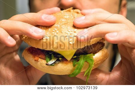 Man eating an hamburger in a fast food poster