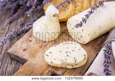 Butter with dried lavender flowers wrapped in parchment