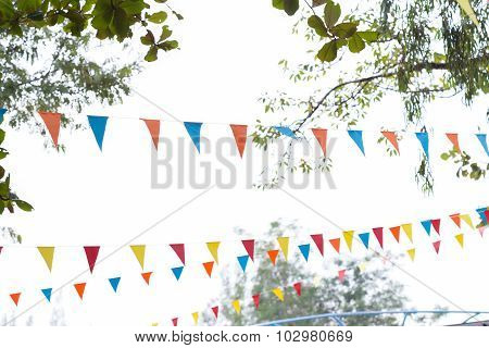 colorful triangular flags of decorated celebrate outdoor party poster