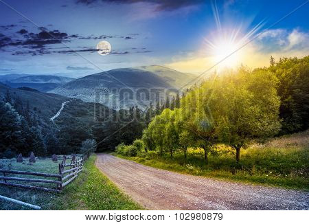 Fence Near Road Down The Hill With  Forest In Mountains Day And Night