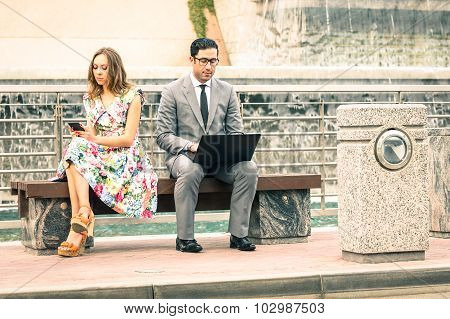 Couple In Moment Of Disinterest  - Break Up Concept And New Technologies Addiction - Business Time