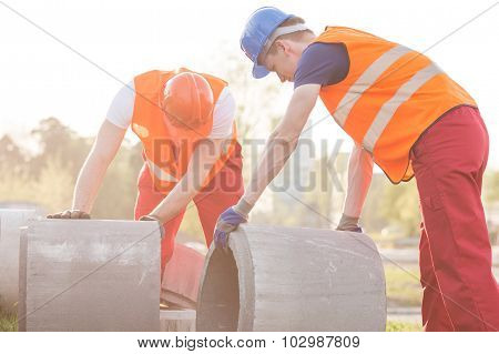 Construction workers are evaluating the state of the kerbs poster