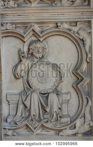 PARIS, FRANCE - SEPTEMBER 8, 2014: Paris - the Sainte-Chapelle (Holy Chapel).The base of the portal on both sides is decorated with low relief representing scenes of the Genesis