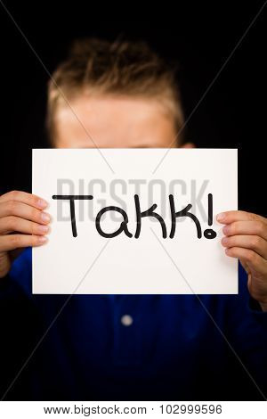 Child Holding Sign With Norwegian Word Takk - Thank You