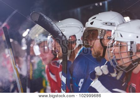 ice hockey players,  group of people,  team friends waiting and relaxing on bench to start  game