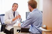 Male Patient Having Consultation With Doctor In Office poster