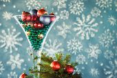 Christmas gift decoration - Wine glass filled with christmas tree balls and glass beads. Festive cocktail. poster