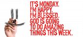 Hand with marker writing: Its Monday Im Happy Im Blessed God Is Going to do Amazing Things This Week poster