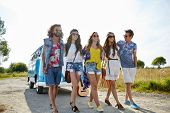 summer holidays, road trip, vacation, travel and people concept - smiling young hippie friends walking over minivan car poster