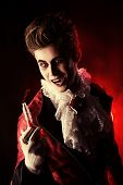 Frightening vampire holding youth elixir. Halloween. Dracula costume. poster