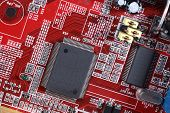 Close-up of electronic circuit red board with processor of computer motherboard poster