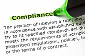 Definition of the word Compliance highlighted with green felt tip pen. poster