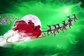 Santa Claus riding a sleigh led by reindeers delivering gifts poster