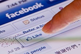 Macro image of clicking the Like button in facebook