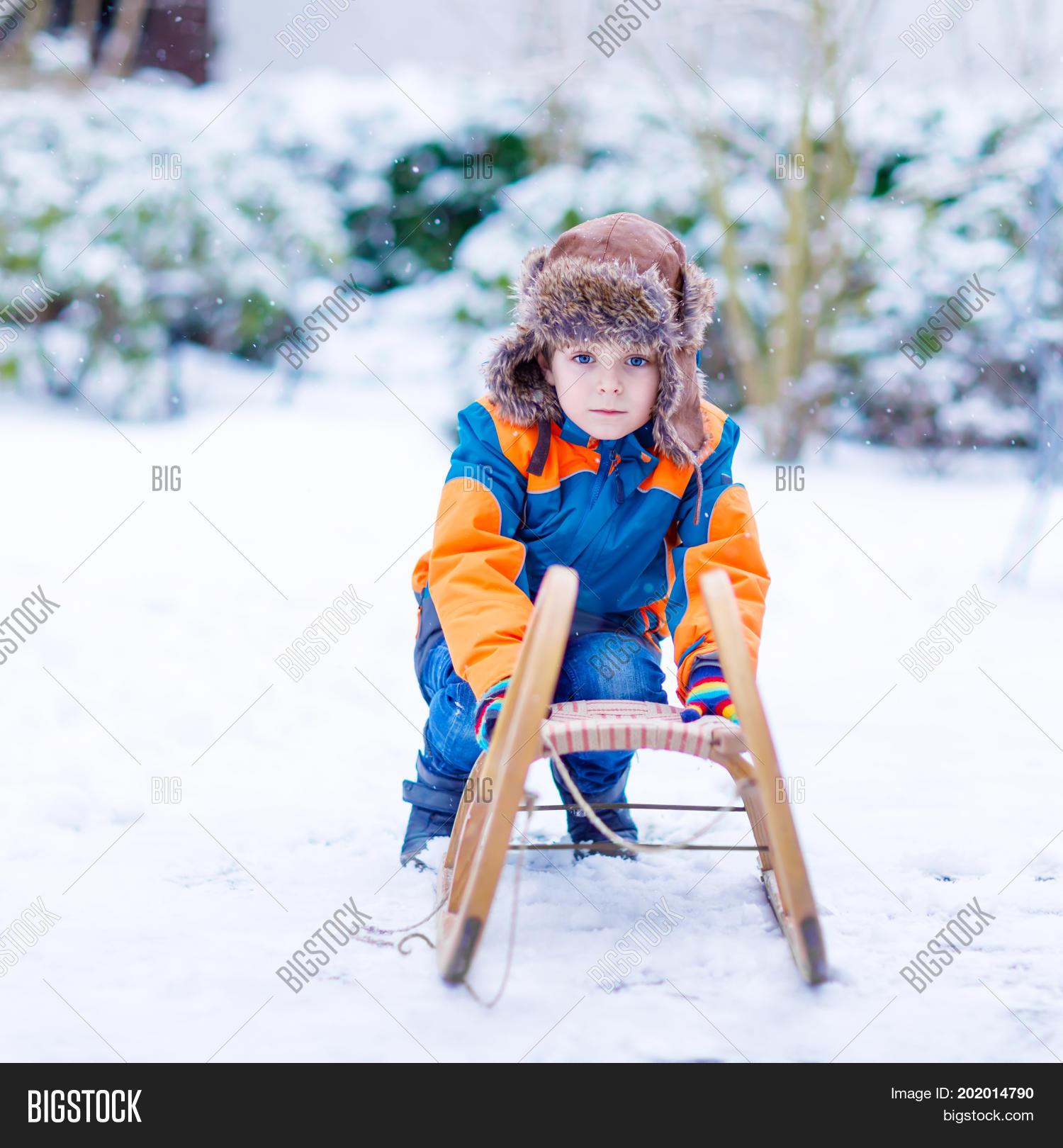 Christmas Vacation Sled.Little Boy Enjoying Image Photo Free Trial Bigstock