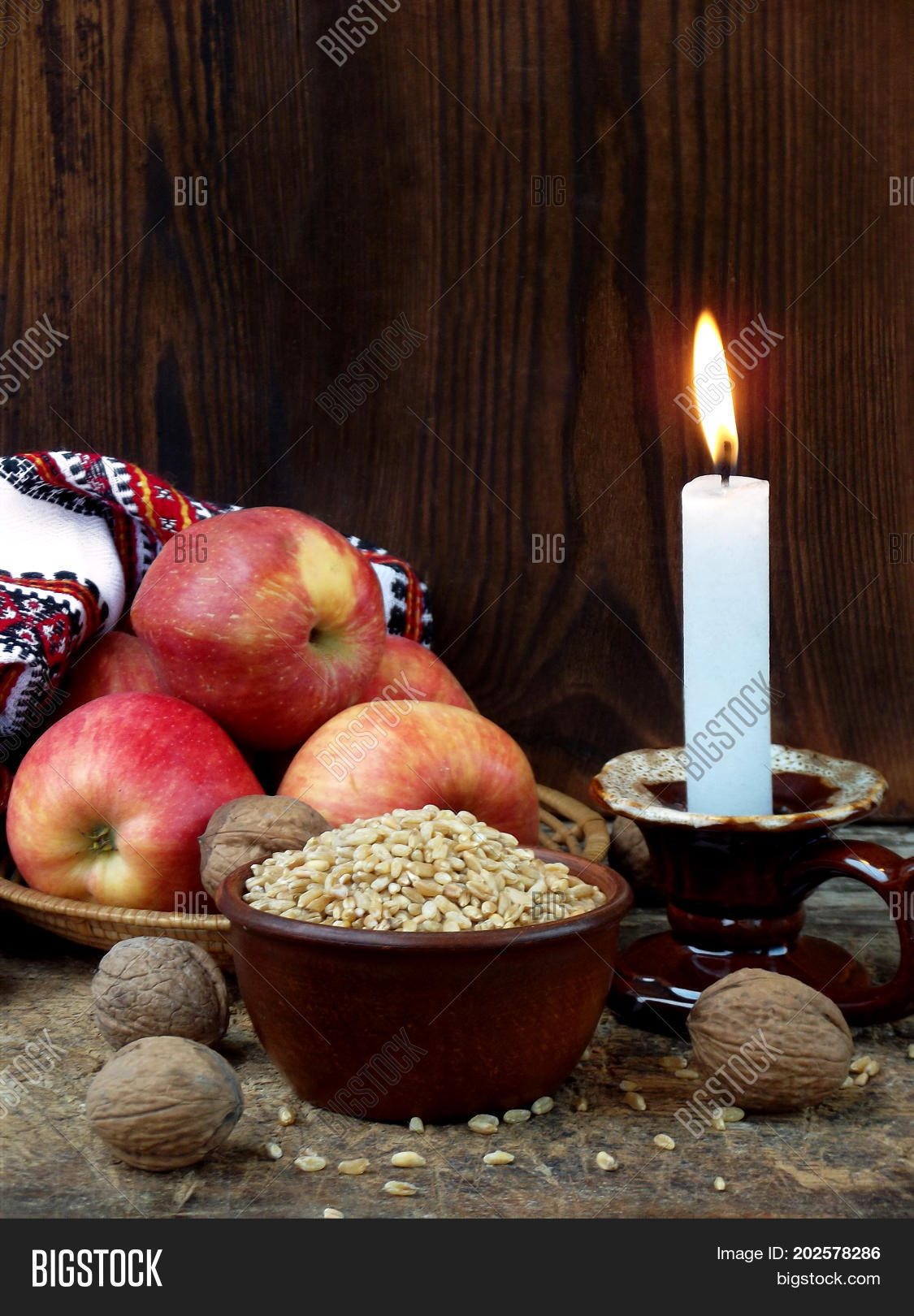 Ukrainian christmas image photo free trial bigstock ukrainian christmas concept for greeting card composition of burning candle apples walnuts m4hsunfo