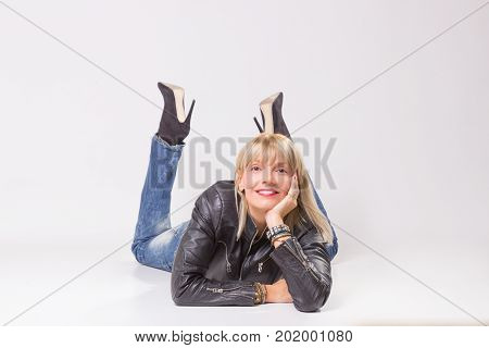 Mature Woman 40S Lying On Floor, Looking At Camera