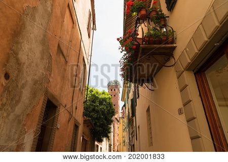 LUCCA, ITALY - MAY 23, 2017: Narrow old cozy street in Lucca. Lucca is a city and comune in Tuscany. It is the capital of the Province of Lucca