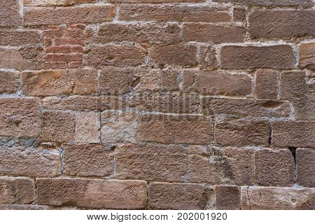 Brick wall texture grunge background with vignetted corners, may use to interior design