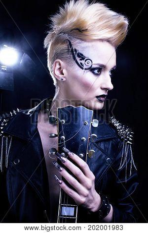Fashion Rocker Style Model Girl Portrait. Hairstyle. Punk Woman Makeup, Hairdo and black Nails. Smoky Eyes at halloween