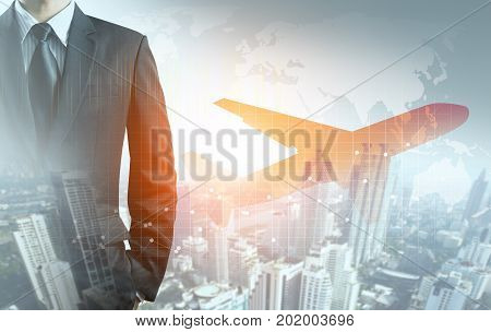 businessman and airplane with graph, city and world map background