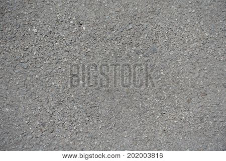 Macro Of Grained Texture Of Dusty Asphalt
