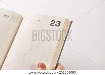 Businessman's Hand Holding Calendar Work Planer