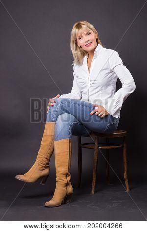 Beautiful Mature Woman 40S Sitting In Chair Studio