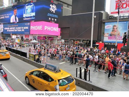 New York City USA June 19 2017 crowds of people in N Y waiting in line to get tickets to Broadway plays - editorial use only