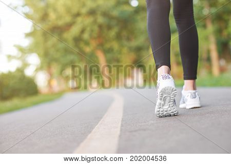 Cropped shot of the legs of a fitness woman running in the forest copyspace sport motivation energy endurance athletics cardio workout concept.