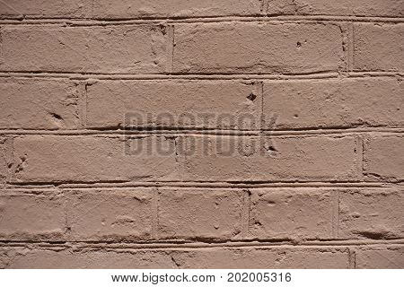 Close Up Of Uneven Painted Brick Wall