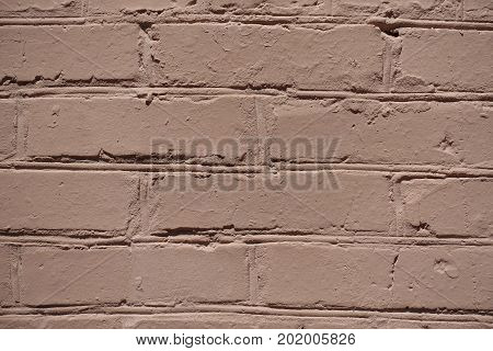 Macro Of Uneven Brown Painted Brick Wall