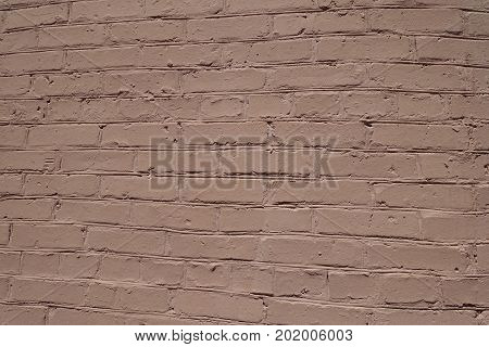Surface Of Uneven Brown Painted Brick Wall