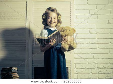 Little Baby Secretary In Cabinet With Bear.
