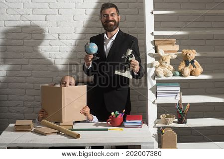 Girl And Father In Classroom On White Brick Background.