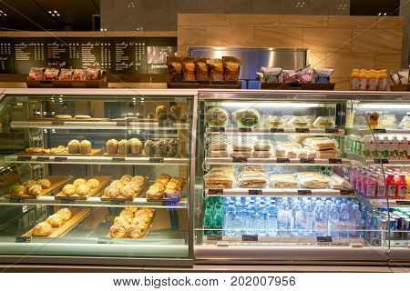 DOHA, QATAR - CIRCA MAY, 2017: food, snacks and beverages on display at Hamad International Airport of Doha.
