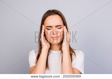 Strong Migraine. Struggling Beautiful Young Lady With Strong Pain Grimace. She Is Wearing The Casual